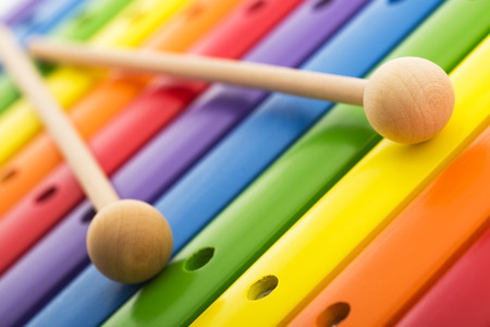 wooden toy: Rainbow colored wooden toy xylophone Stock Photo