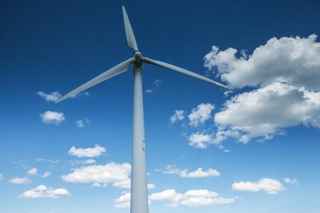renewable energy resources: Green renewable energy concept - wind generator turbines in sky