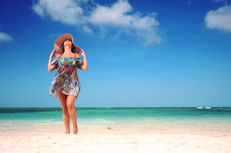 carribean: Young woman dancing on exotic carribean beach Stock Photo