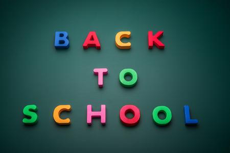 Back to school text write with wooden alphabet in blackboard. Zdjęcie Seryjne