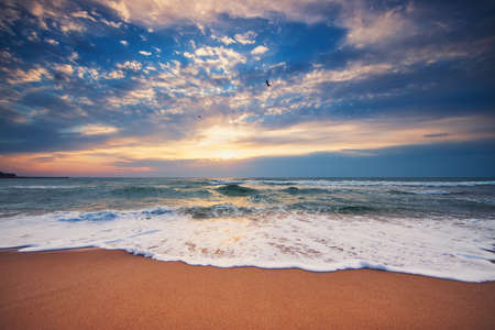 Dramatic cloudscape over the sea, sunrise shot Reklamní fotografie