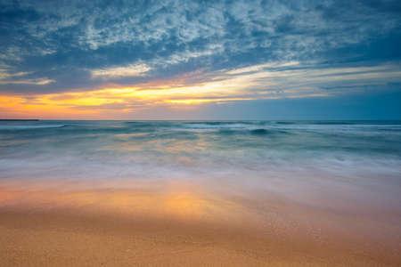 Beach sunrise over the sea and dramatic sea Reklamní fotografie