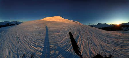 wintersport: 270 degree panoramic image of the Swiss alps at sunset.