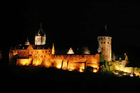 particularly: City castle of Altena, Germany illuminated at night. High resolution shot depicting a particularly rustic castle of central Europe. This not-so-famous castle brings a lot of medieval atmosphere to any design purpose...