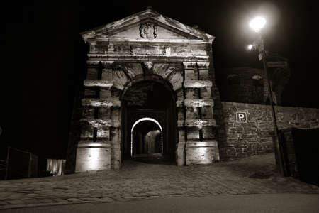 hostel: Entrance gate to the city castle in Altena, Germany, at night (location of the first youth hostel in the world). Quadtoned image, accentuating contrast brought out by lighting. Stock Photo