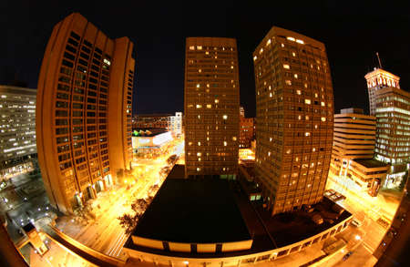 md: The harbordowntown area of Baltimore, MD, USA at night taken with a fisheye lens.