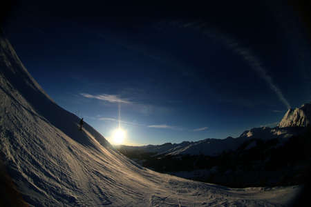 wintersport: Fisheye shot of a skiing slope in the alps. Stock Photo
