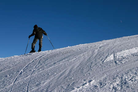 wintersport: A young man on skis, mastering the mountains. Stock Photo