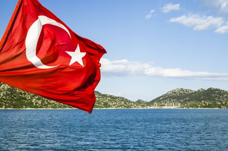 Turkish flag on a background of the sea coast photo