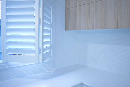Partly opened bifold plantation shutters.