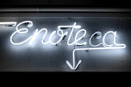 Blue neon signboard of INFORMS you in italian winehouse. photo