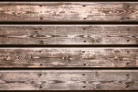 evident: Wooden planks in neutral tones and veins evident.