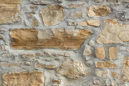 irregular shapes: A wall with large stones in irregular shapes. Stock Photo