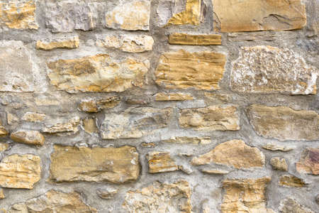 irregular shapes: Details of a wall with big stones in irregular shapes. Stock Photo