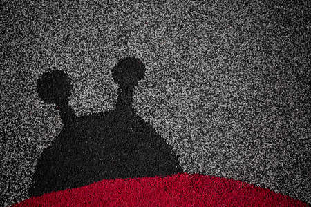 tot: The silhouette of a ladybug on linoleum. Stock Photo