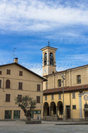 A view on the square of a small Italian church. Stock Photo
