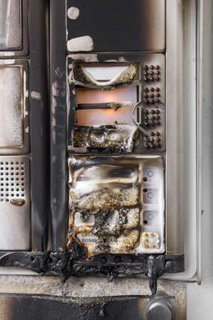 intercom: An intercom system of a building, on fire by vandals. Stock Photo