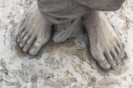 Marble sculpture depicting Jesus feet.