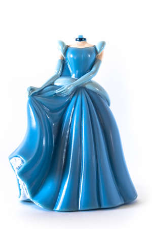 forgetful: Puppet on a white background of a Cinderella without the head. Stock Photo