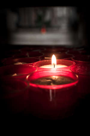 church group: Group of red candles in a church. Stock Photo