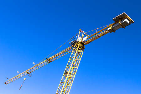 market bottom: A yellow crane and a cobalt blue sky in the background.