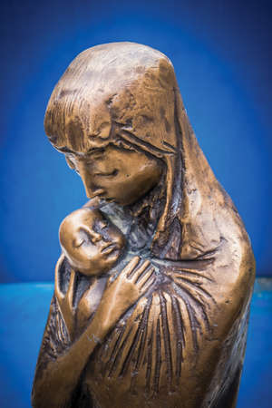Bronze statue depicting the Madonna with child.