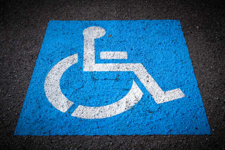 reserved seat: Indication of reserved seat for disabled parking. Stock Photo