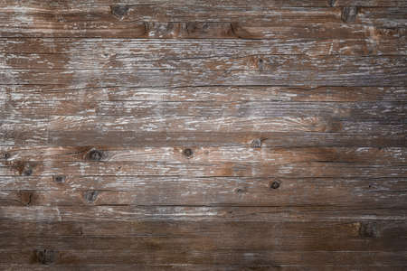 Planks of rustic wood with dark brown tones.