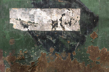 weathering: A metal panel Attacked by rust and weathering.