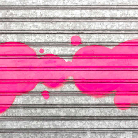 vandalism: A pink cloud painted with spray paint on a roller shutter.