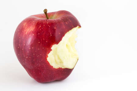 seven deadly sins: Close-up of an bitten apple on white background and copy space. Stock Photo