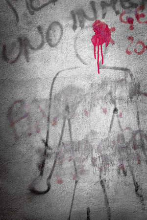 human's arm: Graffiti on the wall representing a murder of an innocent.