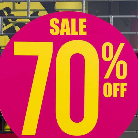 70 s: A large sticker balances on a store window. Stock Photo