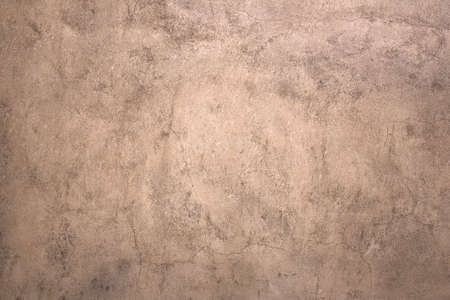 An old wall finished with stucco with brown tones. photo