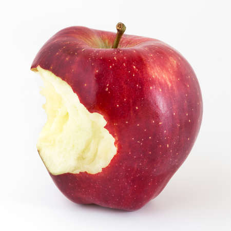 seven deadly sins: Close-up of an bitten apple on white and copy space.