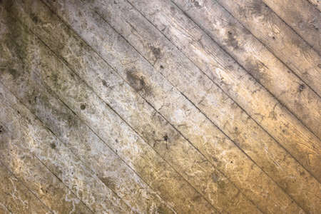 designates: Background characterized by wooden planks deteriorated by time and by the elements. Stock Photo
