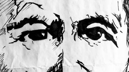 Close up of two eyes drawn on paper in black and white.