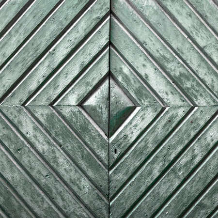 Details of an old wooden door with diamond pattern. photo