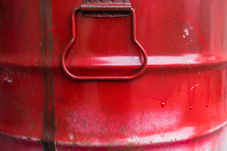 grease paint: Extreme close up of a red barrel of oil. Stock Photo