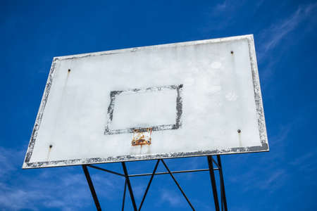 consumed: An old basketball hoop consumed by games and matches.