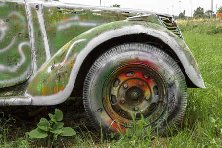 rust metal: An old abandoned pickup truck, painted with bright colors.