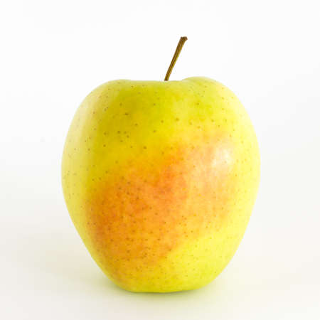 integrates: An integrates green apple isolated on a white background.