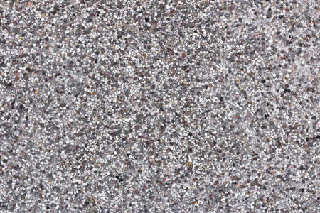 grays: Backdrop composed of tiny white pebbles, grays and browns.