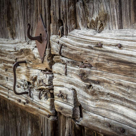 skinning: An old wooden door exposed to the elements.