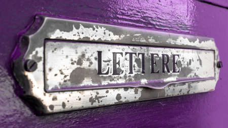 mail slot: An old letter box of a door painted of purple.