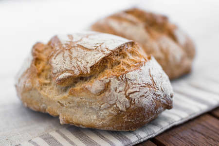 Extreme clos-up of rustic Italian bread, isolated on background out of focus. Stockfoto