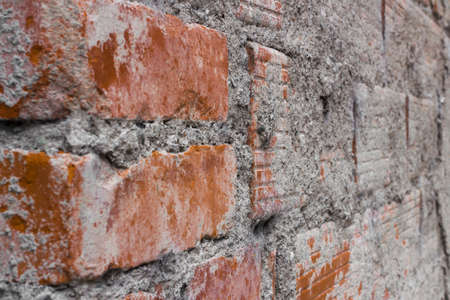 redbrick: Details of a brick wall and concrete unfinished.