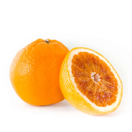 intact: Close up of half orange and one intact, on white. Stock Photo