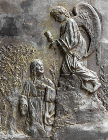 christian halloween: Bas relief depicting Christ kneeling who meets an angel.