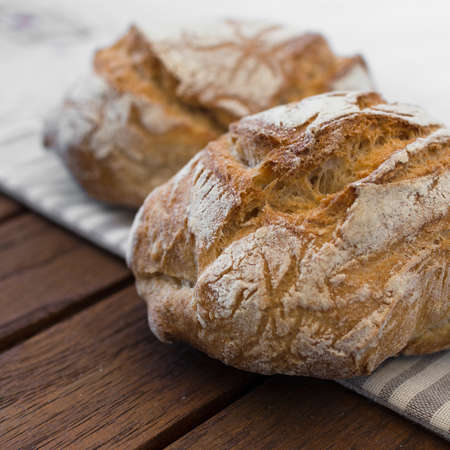 Extreme clos-up of rustic Italian bread, isolated on background out of focus. Standard-Bild